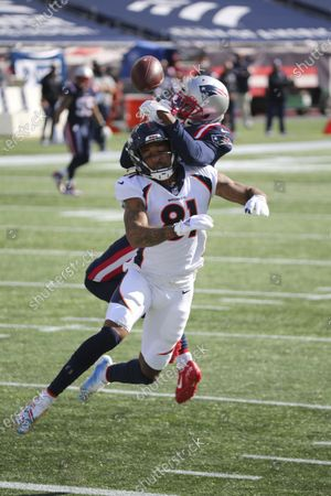 New England Patriots defensive back J.C. Jackson, back, knocks the ball free from Denver Broncos wide receiver Tim Patrick (81) during the first half of an NFL football game, in Foxborough, Mass