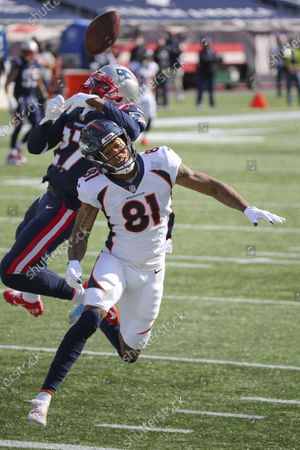 New England Patriots defensive back J.C. Jackson (27) breaks up a pass intended for Denver Broncos wide receiver Tim Patrick (81) during the first half of an NFL football game, in Foxborough, Mass