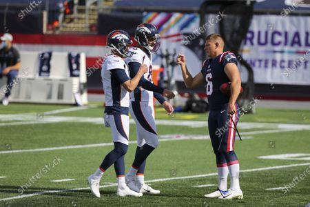 New England Patriots kicker Nick Folk (6) greets Denver Broncos punter Sam Martin (6) and place kicker Brandon McManus (8) prior to an NFL football game, in Foxborough, Mass