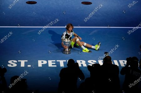 Andrey Rublev of Russia poses with his trophy after winning the final match against Borna Coric of Croatia during their final match of the St.Petersburg Open ATP tennis tournament in St.Petersburg, Russia, 18 October 2020.