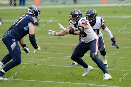 Houston Texans defensive end J.J. Watt (99) plays against Tennessee Titans offensive tackle Dennis Kelly (71) in the first half of an NFL football game, in Nashville, Tenn