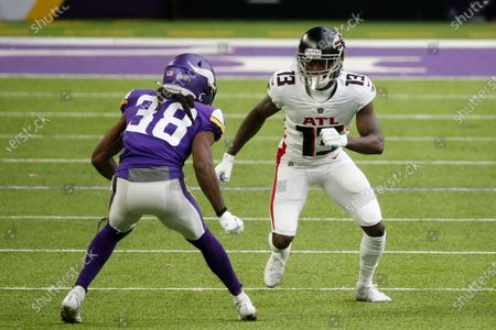 Stock Image of Atlanta Falcons wide receiver Christian Blake (13) runs a route as Minnesota Vikings cornerback Harrison Hand (38) defends during the second half of an NFL football game, in Minneapolis