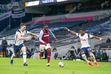Stock Picture of Pierre-Emile Hojbjerg of Tottenham Hotspur, Arthur Masuaku of West Ham United and Serge Aurier of Tottenham Hotspur battle for possesion