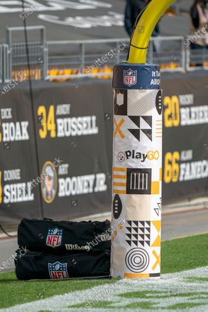 Stock Photo of Play 60 signs and symbols decorate the padding on a goal post during warm ups before an NFL football game between the Pittsburgh Steelers and the Cleveland Brown, in Pittsburgh