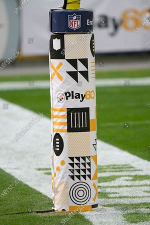 Play 60 signs and symbols decorate the padding on a goal post during warm ups before an NFL football game between the Pittsburgh Steelers and the Cleveland Brown, in Pittsburgh