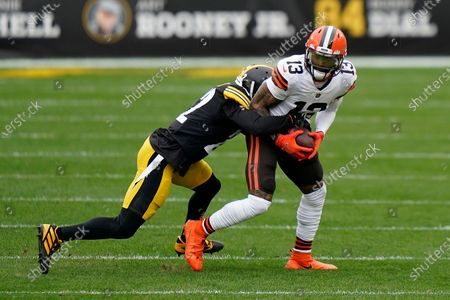 Cleveland Browns wide receiver Odell Beckham Jr. (13) is wrapped up for a tackle by Pittsburgh Steelers cornerback Steven Nelson (22) during an NFL football game, in Pittsburgh