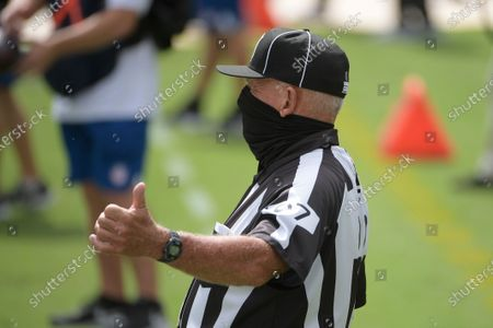 Field judge Tom Hill (97) makes a ruling during the first half of an NFL football game between the Jacksonville Jaguars and the Detroit Lions, in Jacksonville, Fla