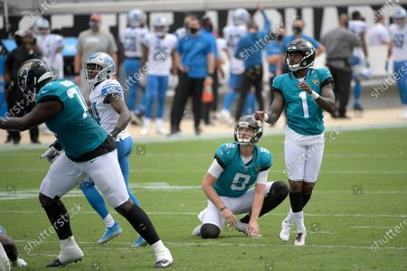Jacksonville Jaguars kicker Jon Brown (1) watches after successfully kicking a field goal during the first half of an NFL football game against the Detroit Lions, in Jacksonville, Fla