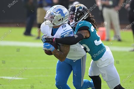 Detroit Lions wide receiver Kenny Golladay, left, makes a reception against Jacksonville Jaguars cornerback Sidney Jones during the first half of an NFL football game, in Jacksonville, Fla