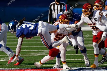 Stock Photo of New York Giants running back Devonta Freeman (31) in action during an NFL football game against the Washington Football Team, in East Rutherford, N.J