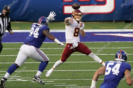 Washington Football Team quarterback Kyle Allen (8) throws a pass as he is pressured by New York Giants nose tackle Dalvin Tomlinson (94) during the second half of an NFL football game Sunday, Oct.18, 2020, in East Rutherford, N.J. The Giants won 20-19