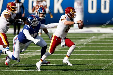 Washington Football Team quarterback Kyle Allen (8) runs away from New York Giants defensive end Leonard Williams (99) during an NFL football game, in East Rutherford, N.J