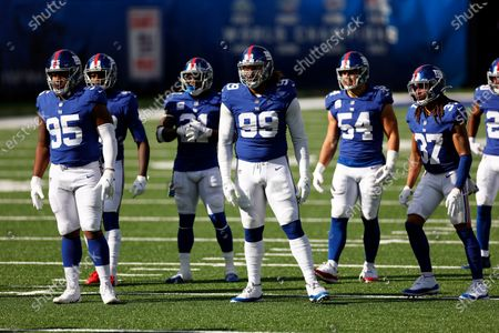 New York Giants defensive end B.J. Hill (95), New York Giants defensive end Leonard Williams (99), New York Giants inside linebacker Blake Martinez (54), New York Giants cornerback Ryan Lewis (37) and New York Giants strong safety Jabrill Peppers (21) during an NFL football game against the Washington Football Team, in East Rutherford, N.J