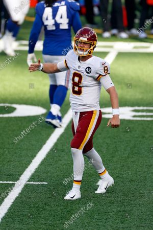 Washington Football Team quarterback Kyle Allen (8) reacts after throwing a touchdown pass during an NFL football game against the New York Giants, in East Rutherford, N.J