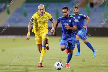 Al-Nassr's player Maicon (L) in action against Al-Fateh's Ali Al-Zaqan (R) during the Saudi Professional League soccer match between Al-Nassr and Al-Fateh at Prince Faisal Bin Fahd Stadium in Riyadh, Saudi Arabia, 18 October 2020.
