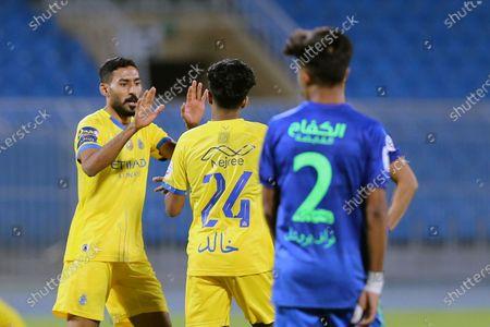 Al-Nassr's player Khalid Al-Ghannam (C) celebrates after scoring a goal with teammate Ali Al-Hassan (L) during the Saudi Professional League soccer match between Al-Nassr and Al-Fateh at Prince Faisal Bin Fahd Stadium in Riyadh, Saudi Arabia, 18 October 2020.