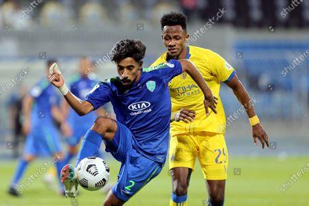Al-Nassr's player Abdulfattah Adam Mohammed (back) in action against Al-Fateh's Nawaf Boushal (front) during the Saudi Professional League soccer match between Al-Nassr and Al-Fateh at Prince Faisal Bin Fahd Stadium in Riyadh, Saudi Arabia, 18 October 2020.