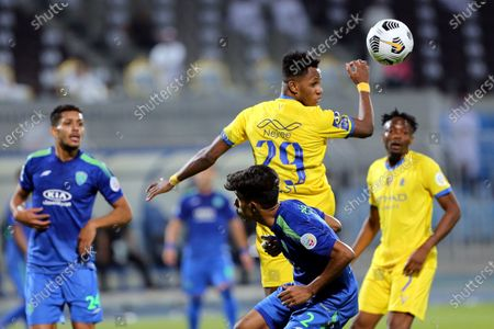 Stock Picture of Al-Nassr's player Abdulfattah Adam Mohammed (back) in action against Al-Fateh's Nawaf Boushal (front) during the Saudi Professional League soccer match between Al-Nassr and Al-Fateh at Prince Faisal Bin Fahd Stadium in Riyadh, Saudi Arabia, 18 October 2020.