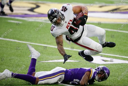 Atlanta Falcons fullback Keith Smith (40) is tackled by Minnesota Vikings cornerback Cameron Dantzler after catching a pass during the first half of an NFL football game, in Minneapolis