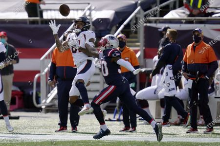 Denver Broncos wide receiver Tim Patrick (81) catches a pass as New England Patriots cornerback Jason McCourty (30) defends in the first half of an NFL football game, in Foxborough, Mass