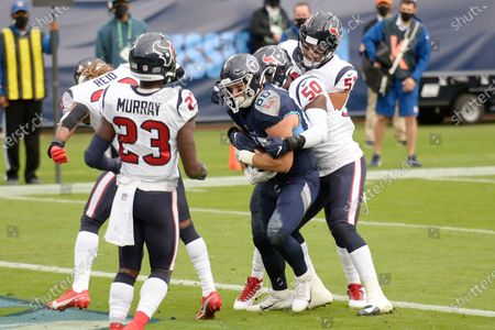 Tennessee Titans tight end Anthony Firkser (86) catches a touchdown pass as he is defended by Houston Texans linebacker Tyrell Adams (50) in the first half of an NFL football game, in Nashville, Tenn
