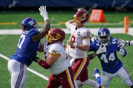 Washington Football Team offensive guard Wes Schweitzer (71) blocks New York Giants' Dexter Lawrence (97) as quarterback Kyle Allen (8) throws a pass during the first half of an NFL football game, in East Rutherford, N.J