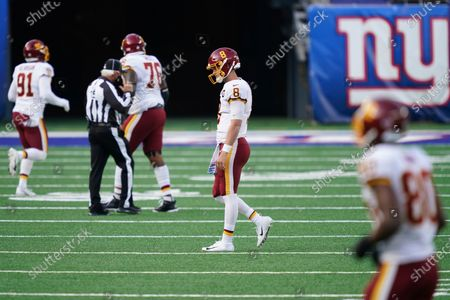 Stock Photo of Washington Football Team quarterback Kyle Allen (8) reacts after fumbling the ball during the second half of an NFL football game against the New York Giants, in East Rutherford, N.J. The ball was recovered by the Giants and returned for a touchdown on the play