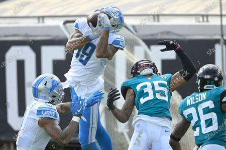Stock Image of Detroit Lions wide receiver Kenny Golladay (19) makes a reception in front of Jacksonville Jaguars cornerback Sidney Jones (35) during the second half of an NFL football game, in Jacksonville, Fla