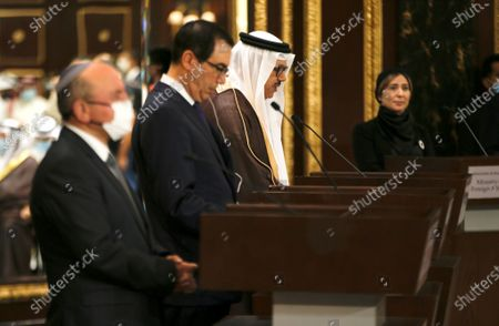 Stock Photo of A Bahraini official speaks next to US Treasury Secretary Steve Mnuchin (C) after signing an agreement with Israeli delegation led by Israeli National Security Advisor Meir Ben Shabbat (L) in Manama, Bahrain, 18 October 2020.