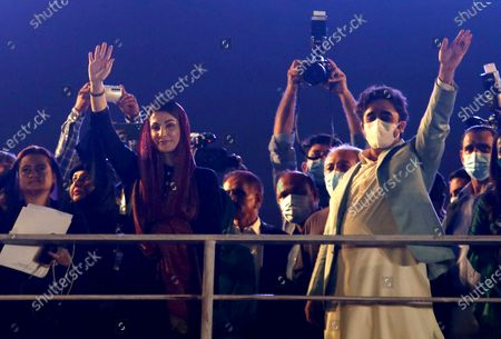 Leaders of opposition party 'Pakistan Democratic Movement' Maryam Nawaz, second left, and Bilawal Bhutto Zardari, right, wave to their supporters as they arrive to attend an anti government rally, in Karachi, Pakistan, . Protests took place in a campaign against Prime Minister Imran Khan to force him step down over what they say is his failure in handling the nation's ailing economy