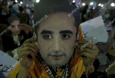 Supporter of Pakistan Democratic Movement displays a cutout of her party leader Bilawal Bhutto Zardari during an anti government rally, in Karachi, Pakistan, . Protests took place in a campaign against Prime Minister Imran Khan to force him step down over what they say is his failure in handling the nation's ailing economy