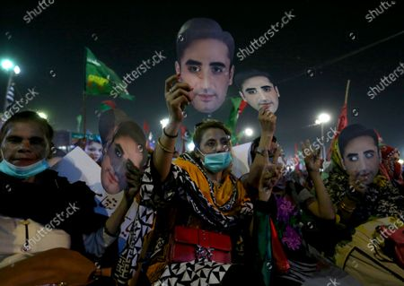 Supporters of the Pakistan Democratic Movement display cutouts of their party leader Bilawal Bhutto Zardari during an anti government rally, in Karachi, Pakistan, . Protests took place in a campaign against Prime Minister Imran Khan to force him step down over what they say is his failure in handling the nation's ailing economy
