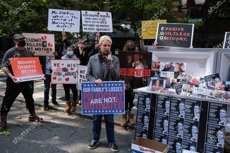 Families of COVID-19 victims who passed away in New York nursing homes gather in front of the Cobble Hill Heath Center to demand New York State Gov. Andrew Cuomo's apologize for his response to clusters in nursing homes during the pandemic on in the Brooklyn borough of New York