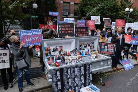 Families of COVID-19 victims who passed away in New York nursing homes gather in front of the Cobble Hill Heath Center to demand New York State Gov. Andrew Cuomo's apologize for his response to clusters in nursing homes during the pandemic, in the Brooklyn borough of New York