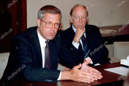 Shows James A. Johnson, left, after being elected by the board of directors to be the new chief executive officer of Fannie May succeeding David O. Maxwell, at right. Johnson, a former Democratic campaign operative who was CEO of housing lender Fannie Mae in the 1990s and served as chairman of Walter Mondale's presidential bid, died at his home in Washington. He was 76