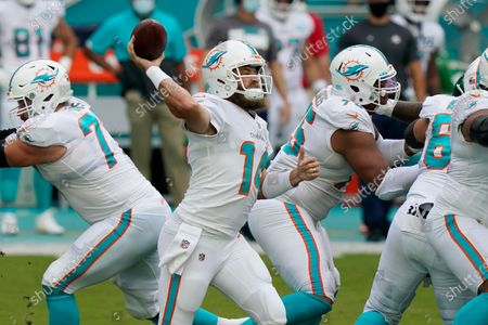 Miami Dolphins quarterback Ryan Fitzpatrick (14) looks to pass the ball during the first half of an NFL football game against the New York Jets, in Miami Gardens, Fla