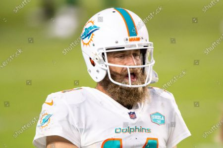 Miami Dolphins quarterback Ryan Fitzpatrick (14) on the sidelines as the Dolphins take on the New York Jets during an NFL football game, in Miami Gardens, Fla