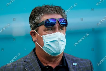 Former Miami Dolphins quarterback Dan Marino watches the team practice before an NFL football game against the New York Jets, in Miami Gardens, Fla