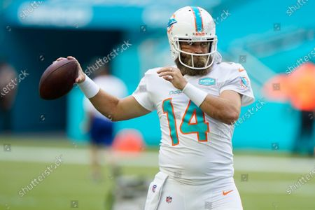 Miami Dolphins quarterback Ryan Fitzpatrick (14) warms up before an NFL football game against the New York Jets, in Miami Gardens, Fla