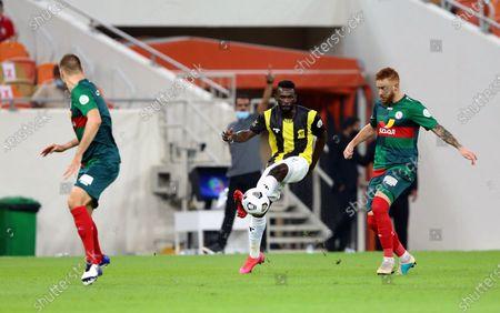 Al-Ittihad's player Abdulaziz Al-Bishi (C) in action agains Al-Ettifaq's Souza (R) during the Saudi Professional League soccer match between Al-Ittihad and Al-Ettifaq at King Abdullah Sport City Stadium, 30 kilometers north of Jeddah, Saudi Arabia, 18 October 2020.