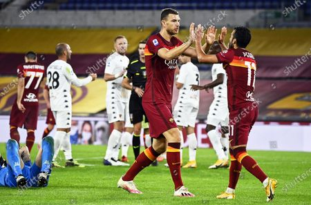Roma players Edin Dzeko (C) and Pedro (R) react during the Italian Serie A soccer match between AS Roma and Benevento Calcio at the Olimpico stadium in Rome, Italy, 18 October 2020.