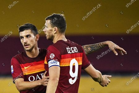 Roma's Edin Dzeko (R) celebrates with teammate Lorenzo Pellegrini (L) after scoring the 4-2 lead during the Italian Serie A soccer match between AS Roma and Benevento Calcio at the Olimpico stadium in Rome, Italy, 18 October 2020.