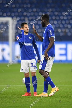 Schalke players Steven Skrzybski (L) and Salif Sane (R) react during the German Bundesliga soccer match between FC Schalke 04 and FC Union Berlin in Gelsenkirchen, Germany, 18 October 2020.