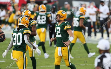 Green Bay Packers quarterback Aaron Rodgers (12) shakes hands with running back Jamaal Williams (30) during the second half of an NFL football game against the Tampa Bay Buccaneers, in Tampa, Fla
