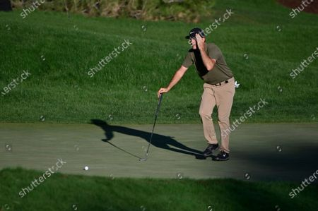 Russell Henley blocks the sun as he lines up a putt on the 18th hole during the final round of the CJ Cup golf tournament at Shadow Creek Golf Course, in North Las Vegas