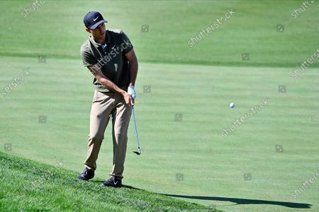 Russell Henley makes his third shot on the fourth hole during the final round of the CJ Cup golf tournament at Shadow Creek Golf Course, in North Las Vegas