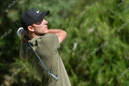Russell Henley makes his tee shot on the fifth hole during the final round of the CJ Cup golf tournament at Shadow Creek Golf Course, in North Las Vegas