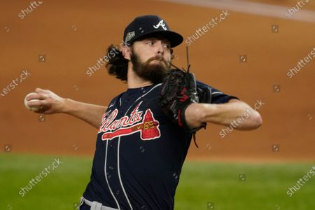 Atlanta Braves starting pitcher Ian Anderson throws against the Los Angeles Dodgers during the first inning in Game 7 of a baseball National League Championship Series, in Arlington, Texas
