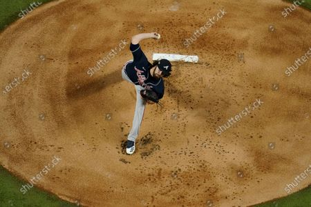 Stock Photo of Atlanta Braves starting pitcher Ian Anderson throws against the Los Angeles Dodgers during the first inning in Game 7 of a baseball National League Championship Series, in Arlington, Texas