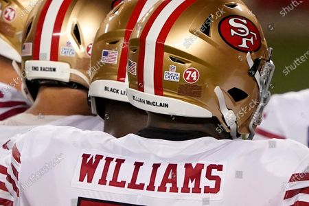 San Francisco 49ers offensive tackle Trent Williams wears the name Elijah McClain on his helmet with a logo for Crucial Catch and a number 74 decal to honor former 49ers player Fred Dean, who died Oct. 14, 2020, during the second half of an NFL football game, against the Los Angeles Rams in Santa Clara, Calif